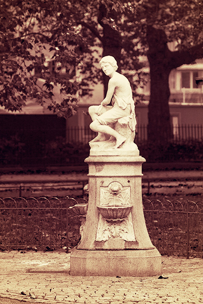 A stone drinking fountain statue opposite Queen Anne's Gate