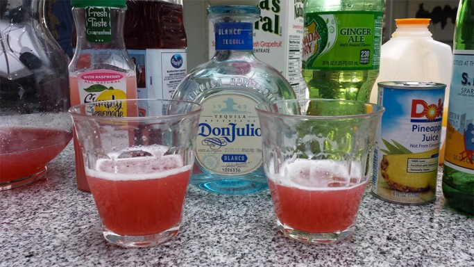 Mixing pink cocktail drinks