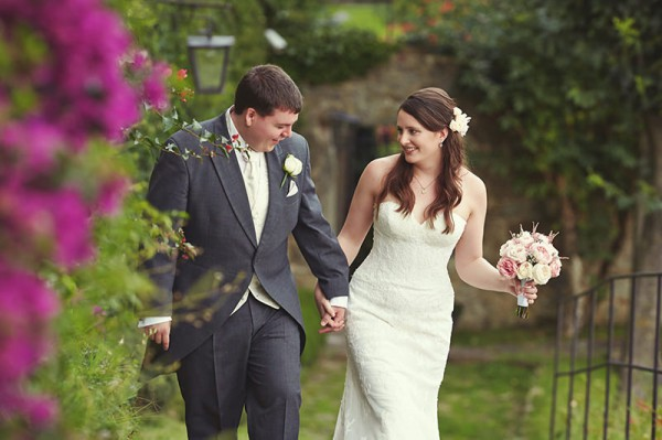 The bride and groom walking