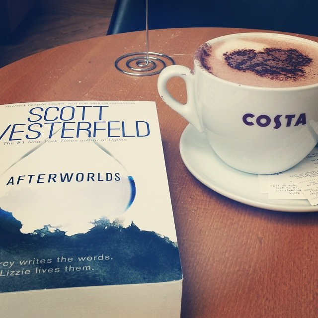 Reading Afterworlds at Costa with a hot chocolate
