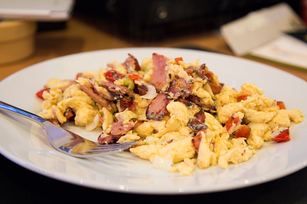 Scrambled eggs with bacon, peppers, and green onion