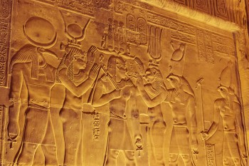 Carvings of gods on the wall at Kom Ombo