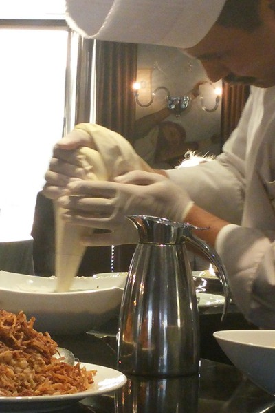 Chef applying whipped cream