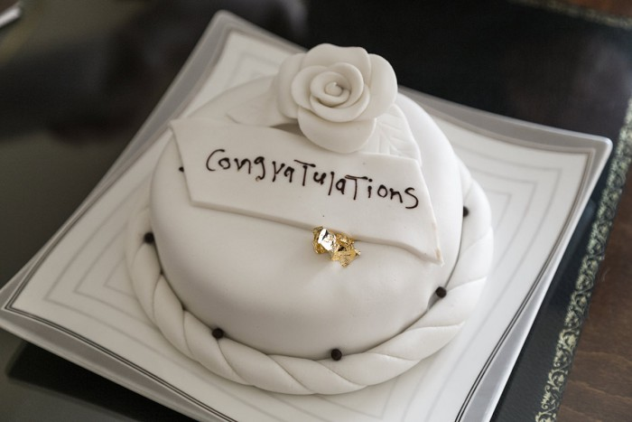 A cake that says 'Congratulations' in icing