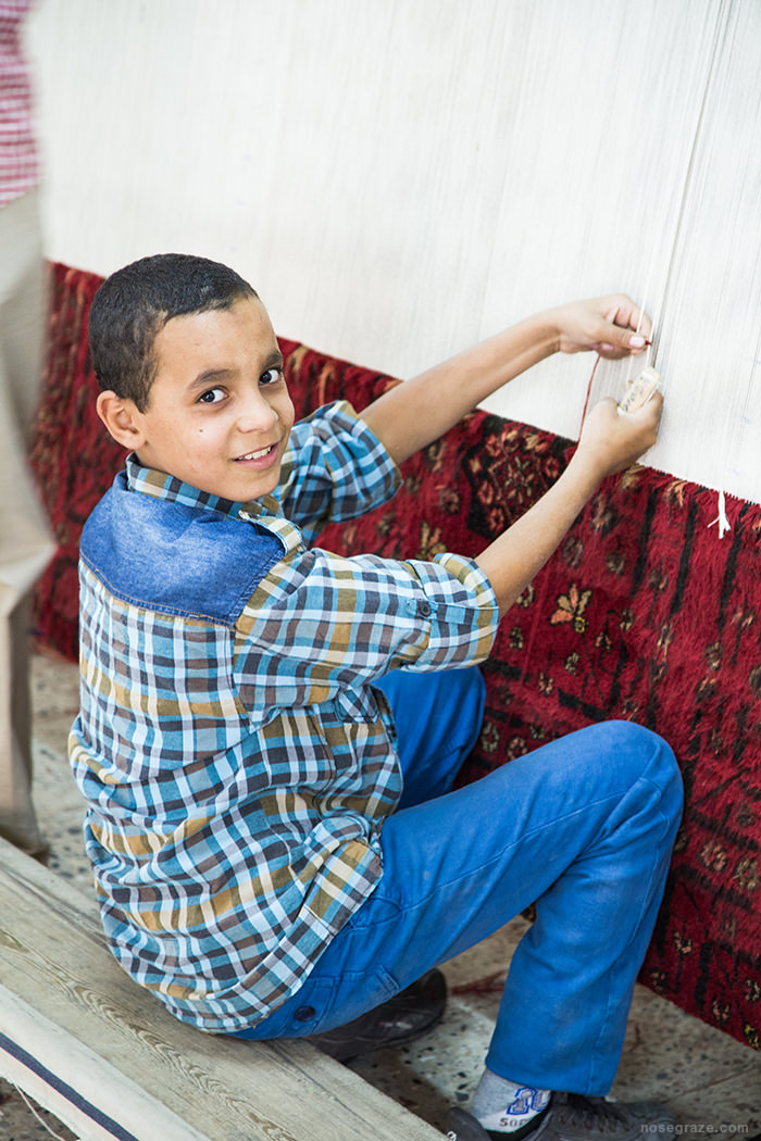 Kid sewing a carpet
