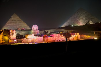 The sphinx and pyramids of Giza lit up at night