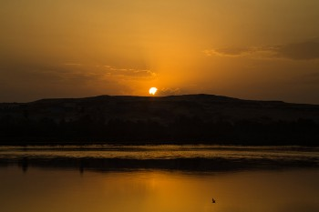 Sunset over the water in Aswan