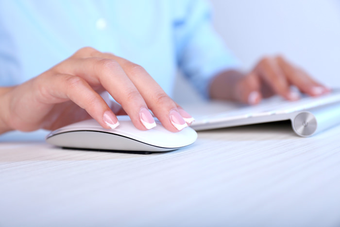 Female hand on Apple mouse
