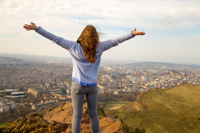 Me spreading my arms on top of Arthur's Seat