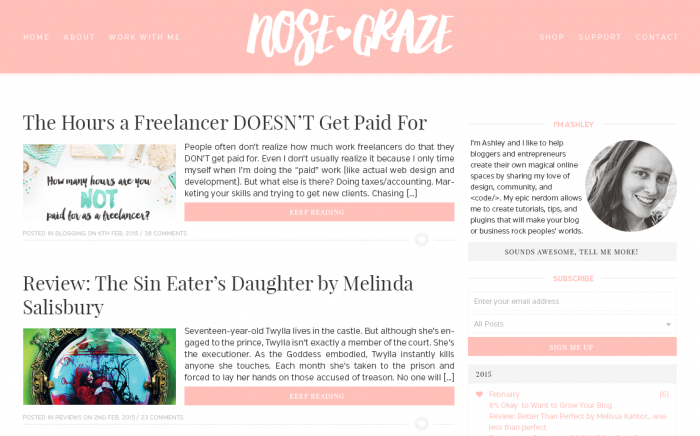 A mockup of a pink blog design with strong serif fonts