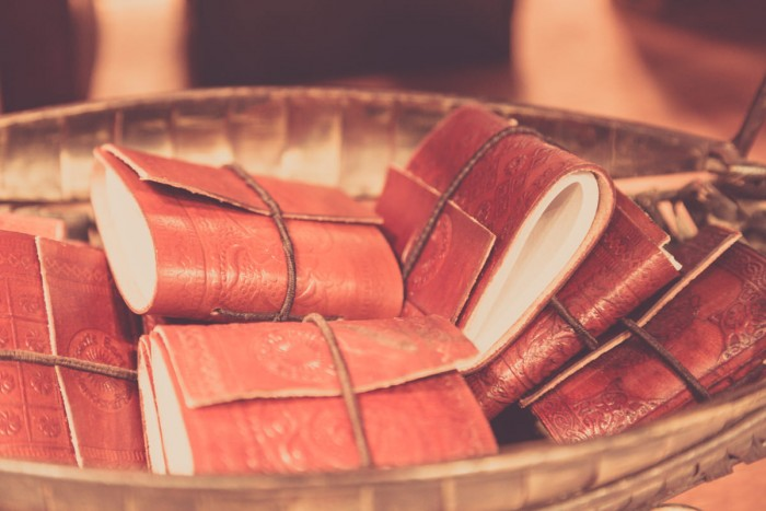 A bowl of mini, red, leather journals