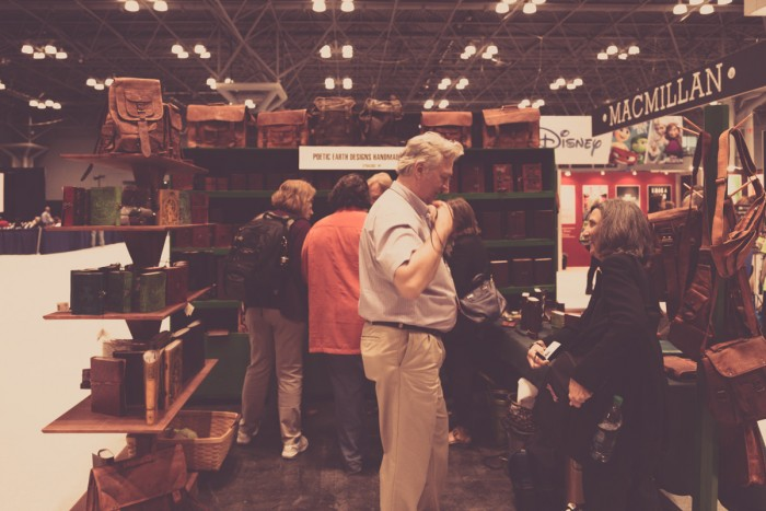 The booth full of leather goods, including journals and bags
