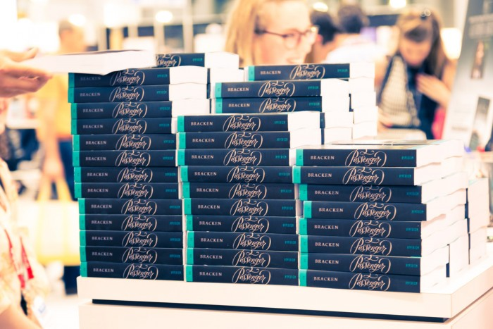 A pile of Passenger ARCs by Alexandra Bracken