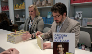 Gregory Scott Katsoulis signing ARCs of All Rights Reserved