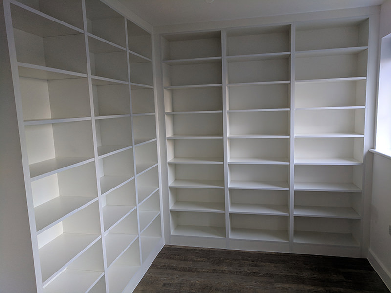 Custom built-in floor to ceiling bookcases