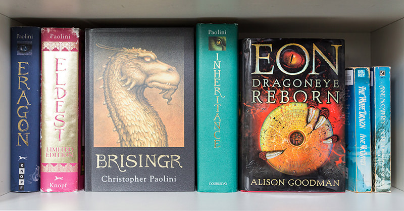 Eon: Dragoneye Reborn on bookshelf with other dragon books